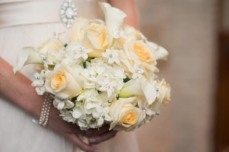 Kim carried a soft, romantic bouquet filled with roses, hydrangeas, calla lilies and hydrangeas.