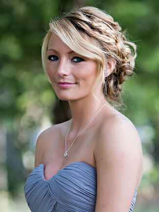 A relaxed braided updo frames the face and looks stunning