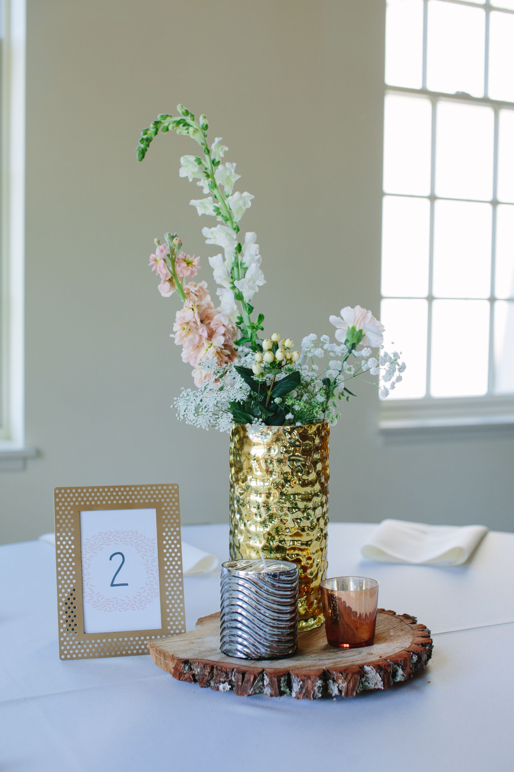 Neutral Colored Flower Centerpiece In Gold Vase