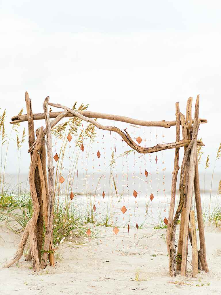 Beach wedding arbor idea with driftwood and seashells