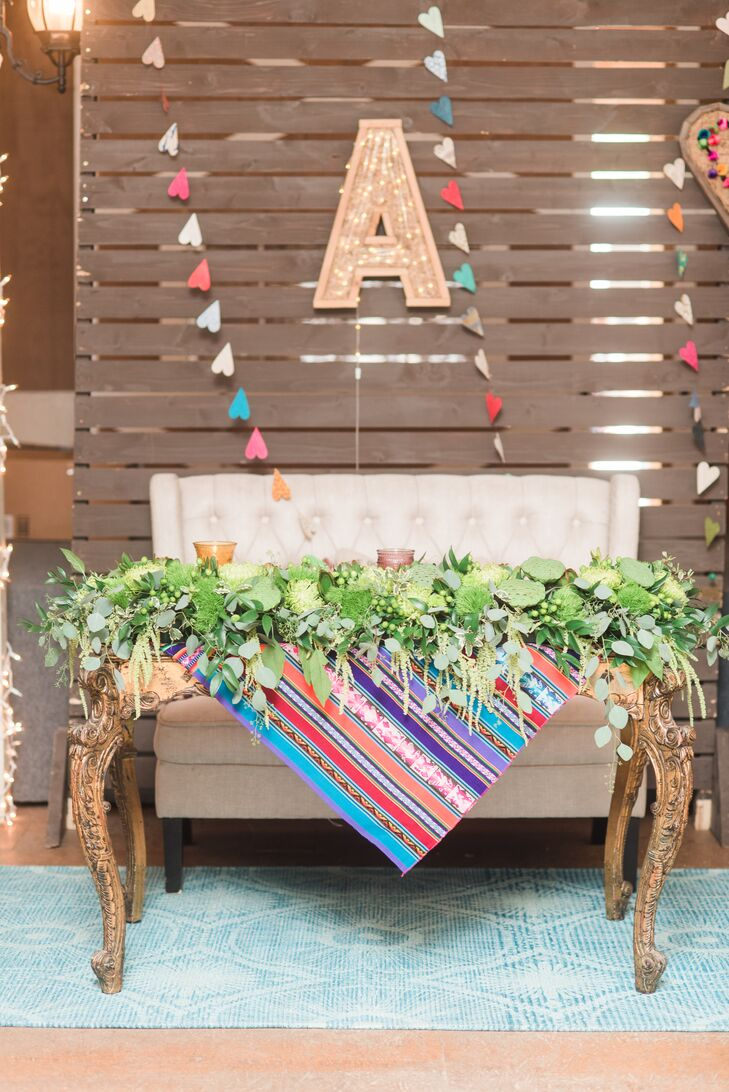 Colorful Cusco Blanket and Green Garland Sweetheart Table Décor