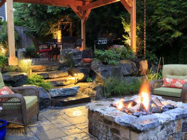 Start warming up to warm weather with a cozy fire pit that you can make yourself.