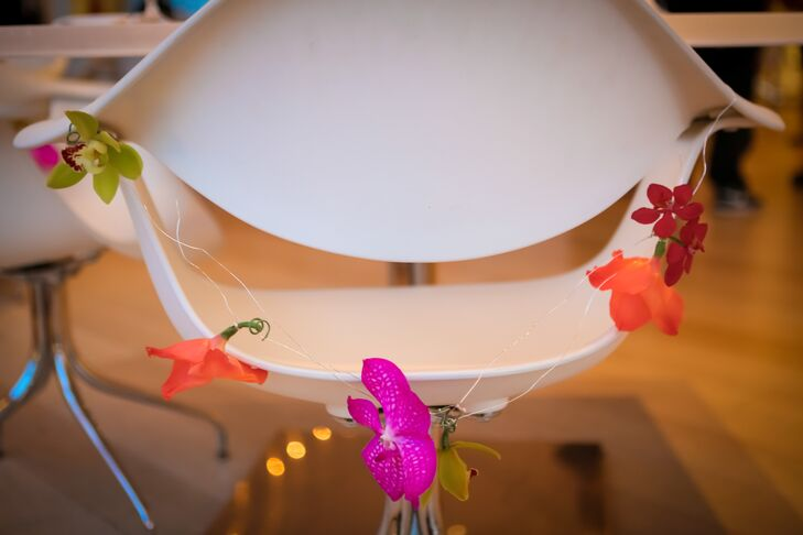 Modern White Chair With Colorful Orchid Drape