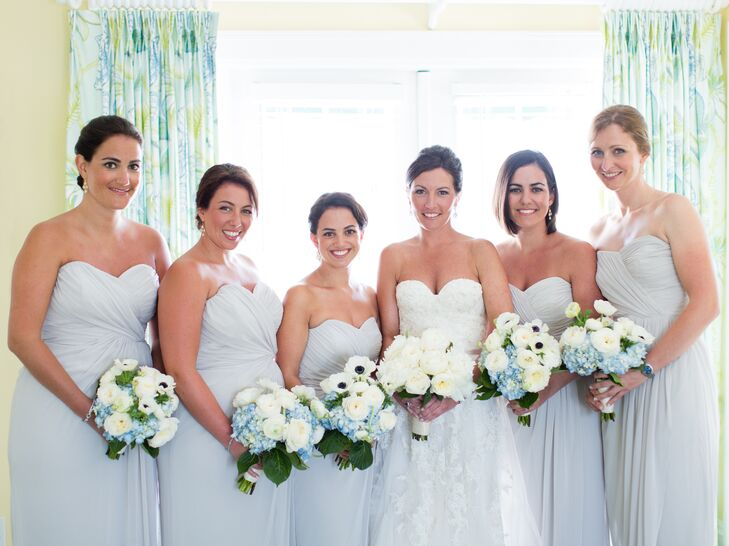 The five bridesmaids wore oyster-colored Dessy dresses with a sweetheart neckline. Margot bought each bridesmaid Julie Vos earrings as a gift to wear.