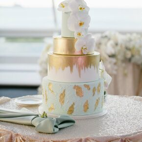 Hand Painted Gold And Mint Wedding Cake