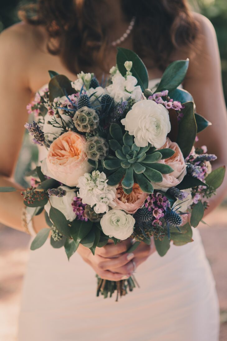 Michelle carried an organic, textured bouquet, which included succulents, scabiosa pods, thistles, garden roses, ranunculus and wax flowers.