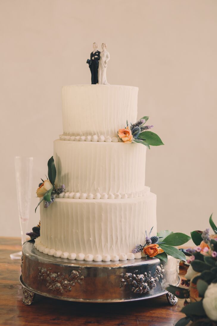Barr Mansion made the couple's carrot cake with a cake topper that was the bride's grandparents'.