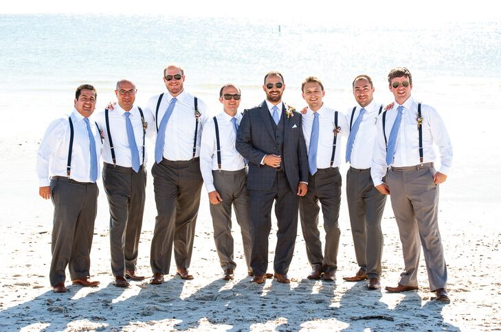 Justin wore a full three piece gray suit, while his groomsmen sported suspenders. All the men wore matching blue ties.
