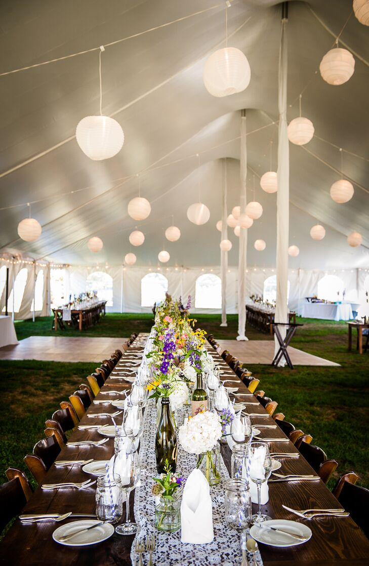 White lanterns hung from the white tent on the Bourne Farm property and lit the evening reception.