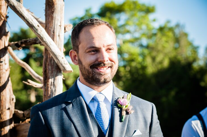 Groom in Gray Suit and Blue Tie at the Altar