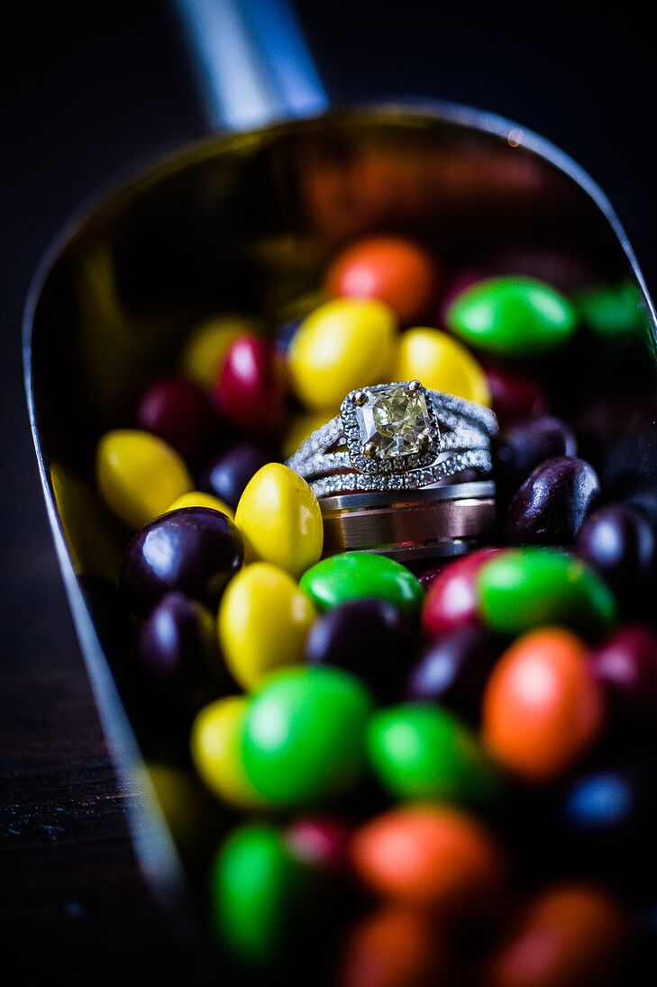 Photographer Kristin Chalmers captured the sparkle of Kara's yellow diamond engagement ring and the couples' wedding bands in a scoop of colorful candies.