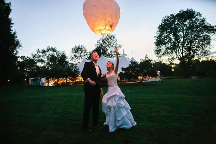 The couple lit sky lanterns, paper lanterns that are typically released at festivals and other celebrations. Emily and Lanyon snuck away to light the first lantern, and then several more were lit behind the tent. The lanterns were used as a way to let the guests know to move into the reception tent.