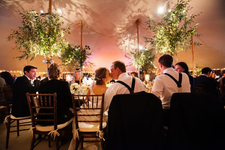The couple brought in six full-size birch trees illuminated by small white lights around the branches.