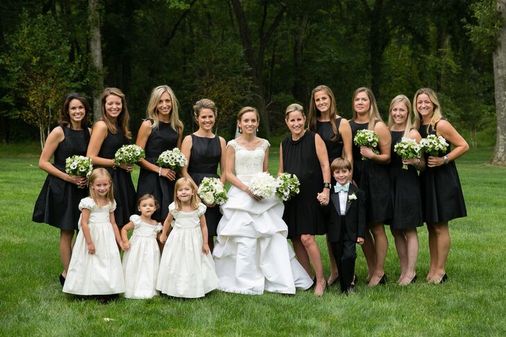 Emily chose the black Jim Hjelm bridesmaids dresses from Here Comes the Bridesmaid in New York City.