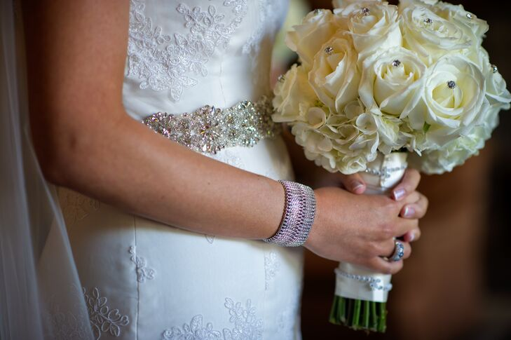 Kim carried an ivory bouquet with roses and hydrangeas. The bouquet was embellished for a little bit of sparkle.