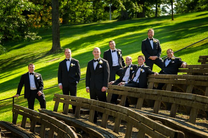 Gregg and his groomsmen wore black tuxedos with black bow ties and white rose boutonnieres.