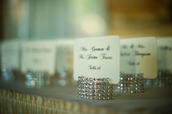 Guests found their calligraphed escort cards displayed on glittering placeholders.