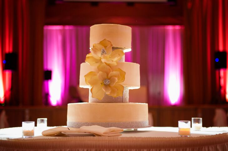 The ivory wedding cake for dessert had separated tiers. It was decorated with crystals and flowers.
