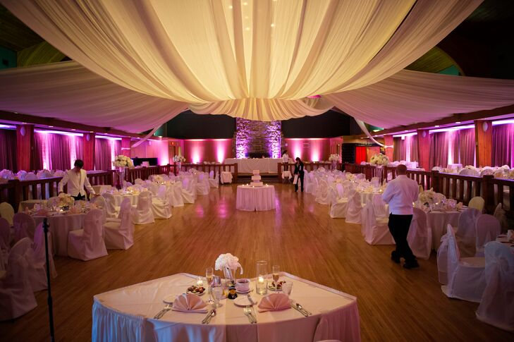 The reception was held in a tented hall at Oglebay Resort. The hall featured hardwood floors and was illuminated with pink up-lighting for the event.