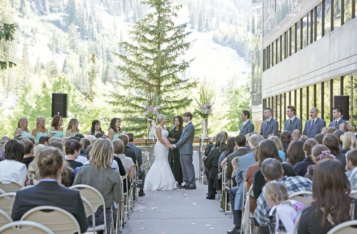 "Miranda and Eric said ""I do"" outdoors with a stunning mountain backdrop. Their officiant customized their ceremony after a series of interviews together and apart, and prepared a wine box for Miranda and Eric to save letters to each other, which they will open on their 10th anniversary."