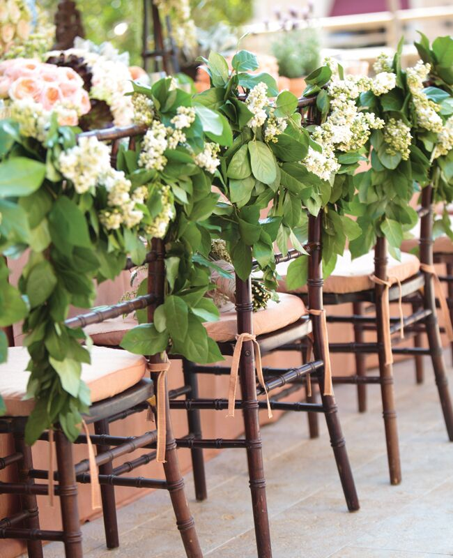 Accent The Garlands With Fresh Blooms That Match Your Wedding Color Palette