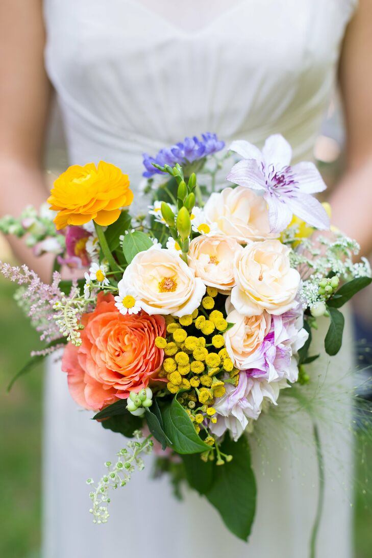 The bridesmaid bouquets were a bright mix of ranunculuses, garden roses, astilbe and lilies.