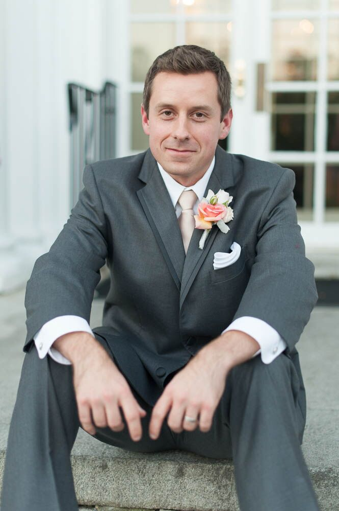 Gray Groom\'s Suit with Peach Tie and Rose Boutonniere