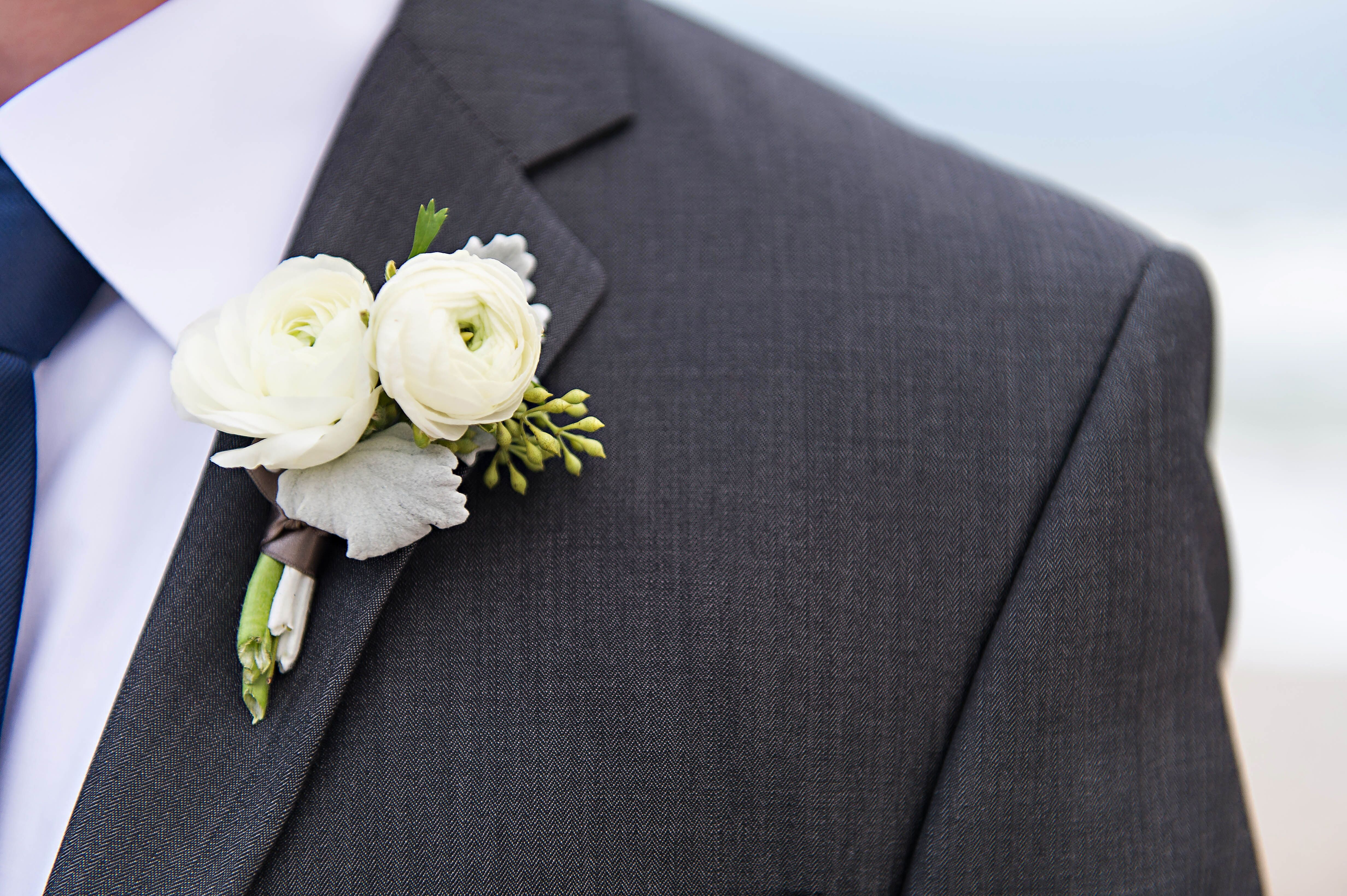 Double White Ranunculus and Dusty Miller Boutonniere