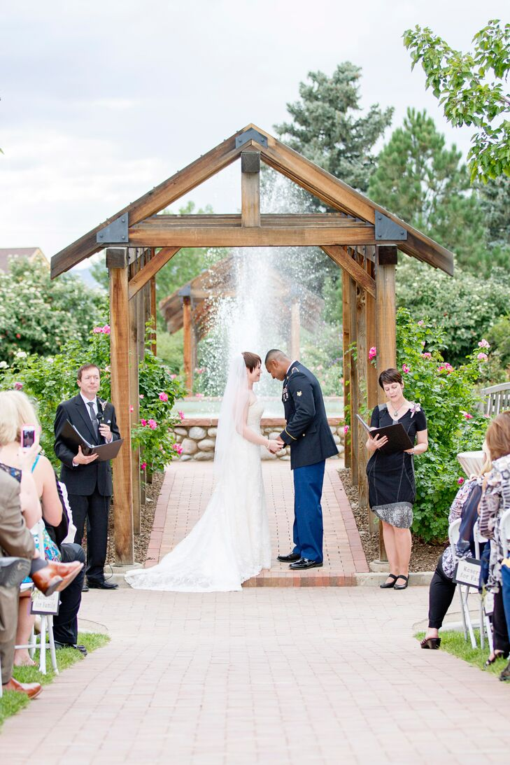 Ashley and Roshan were married in the Rose Garden at Hudson Gardens beneath a wooden pergola. A water fountain and blooming roses provided a natural ceremony backdrop.