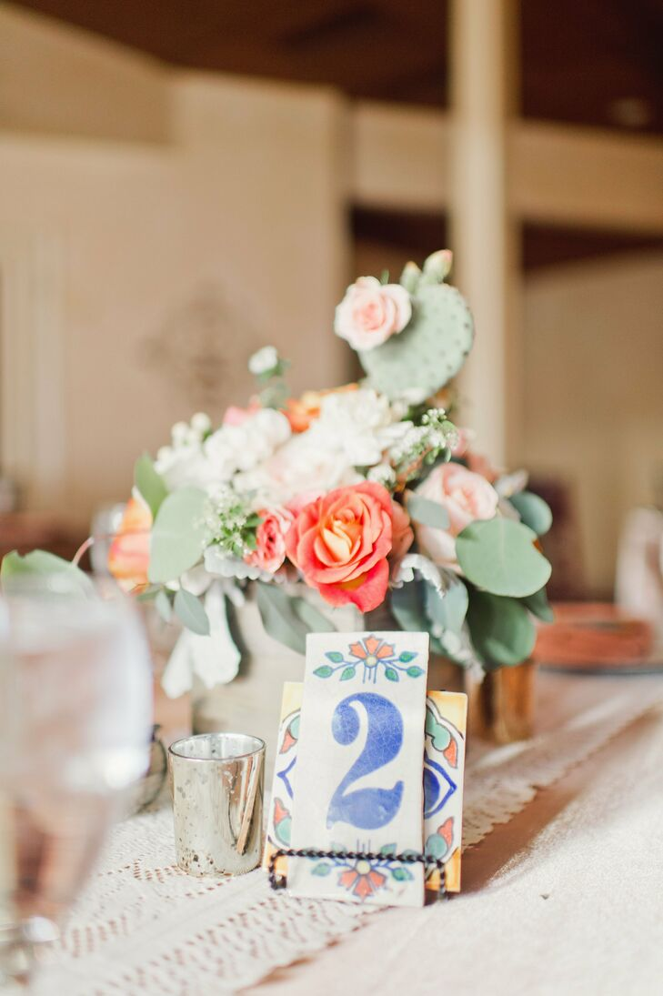 Hand-stamped Spanish tiles served as place cards, and orange blossoms and cacti were a perfect desert-themed centerpiece.