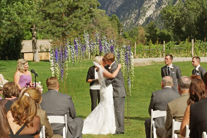 Stephanie and Todd's wisteria-draped arch was an incredibly romantic and beautiful accent to their vineyard ceremony.