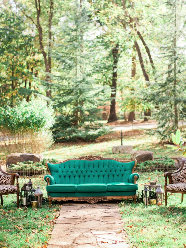 "During the intimate ceremony, guests sat on a vintage Victorian couch, which Layne and Tony sought out for months. ""It took us several weeks of visiting and revisiting antique shops to finally find our little jewel,"" Layne says. She and Tony painted the velvet fabric a vibrant turquoise."