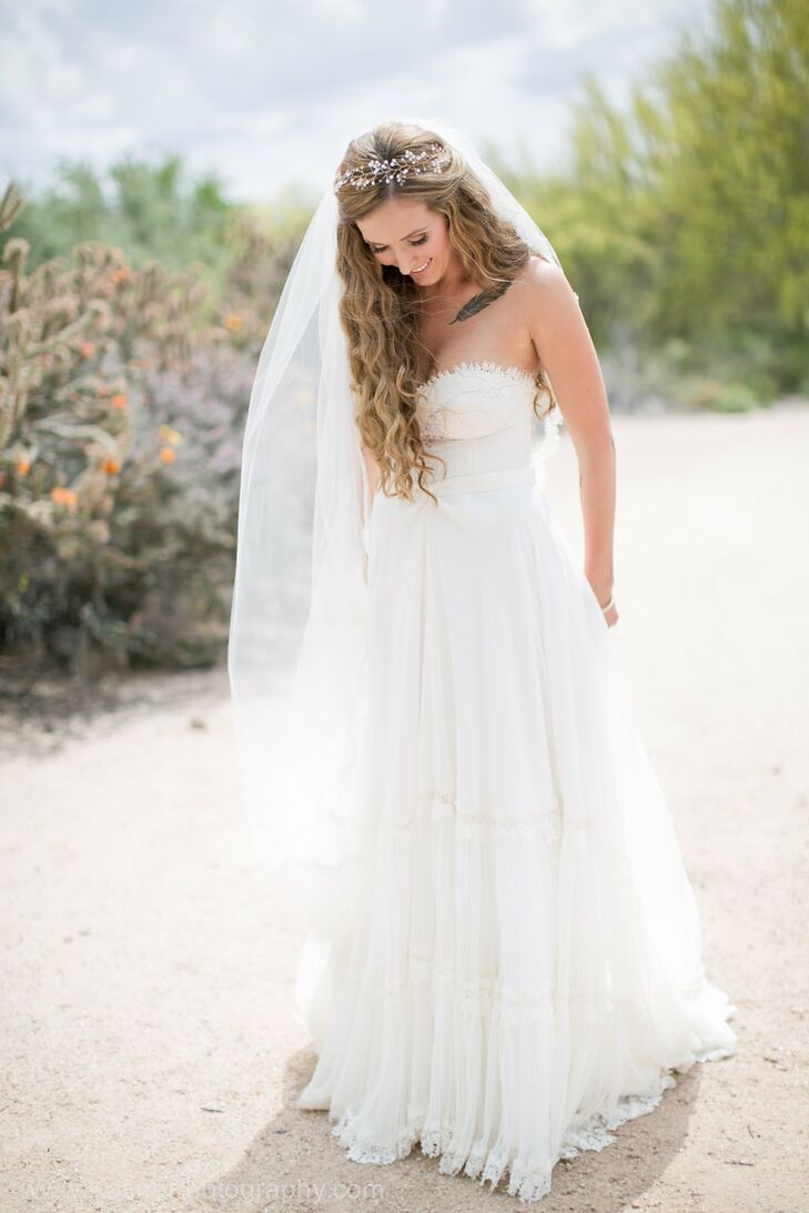 "Amanda ordered her flowing Inbal Dror gown without trying it on. She fell in love with the dress online and ordered it immediately. ""I was able to try on another gown by her with a similar bodice, which helped, but I was confident in her gowns from the moment I saw them,"" she says."