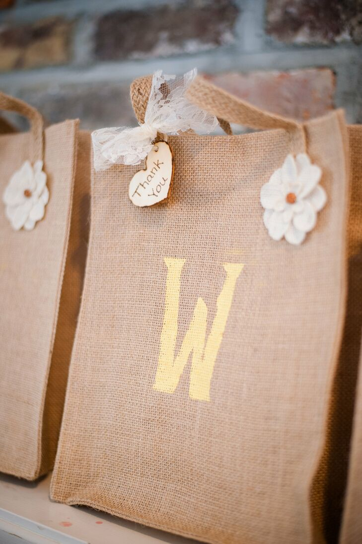 Rustic burlap welcome bags were adorned with wooden tags that Carly's mom personalized using her wood-burning skills. Using twine and wooden hearts, Carly's mom also wood-burned handwritten personal tags that were affixed to champagne glasses for each guest.