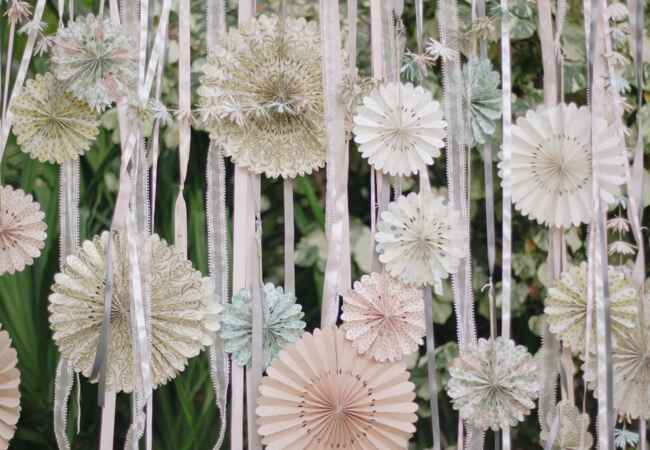 diy paper flower ceremony backdrop | Cristina Elena Photography | Blog.theknot.com