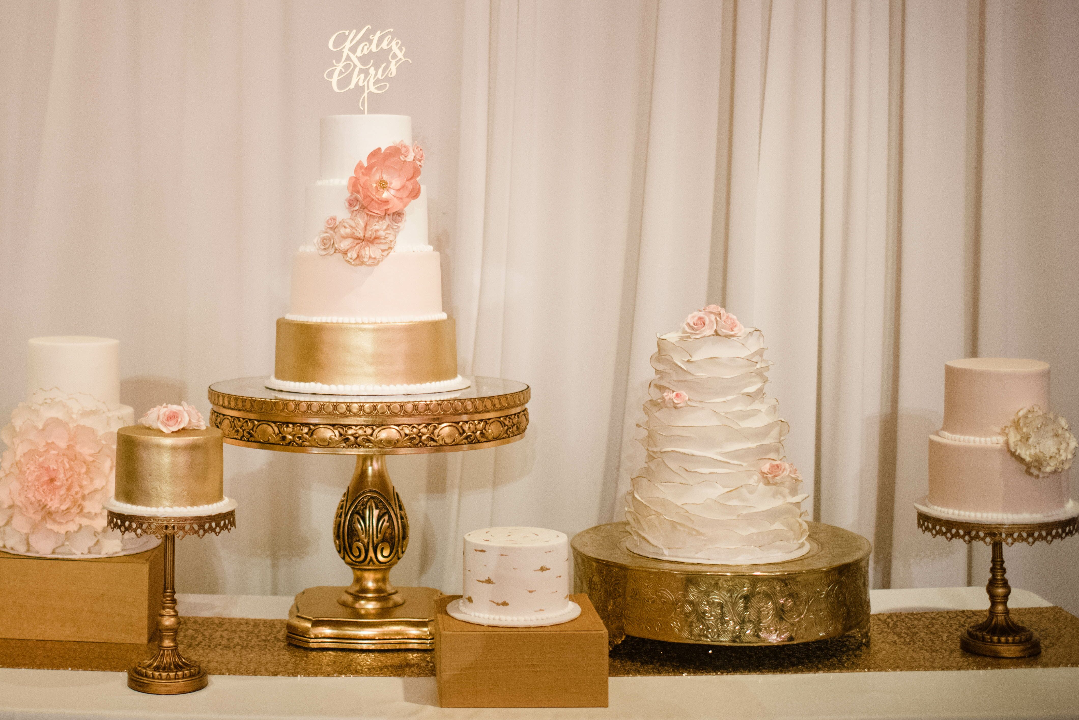 White Blush And Gold Dessert Table With Seven Cakes