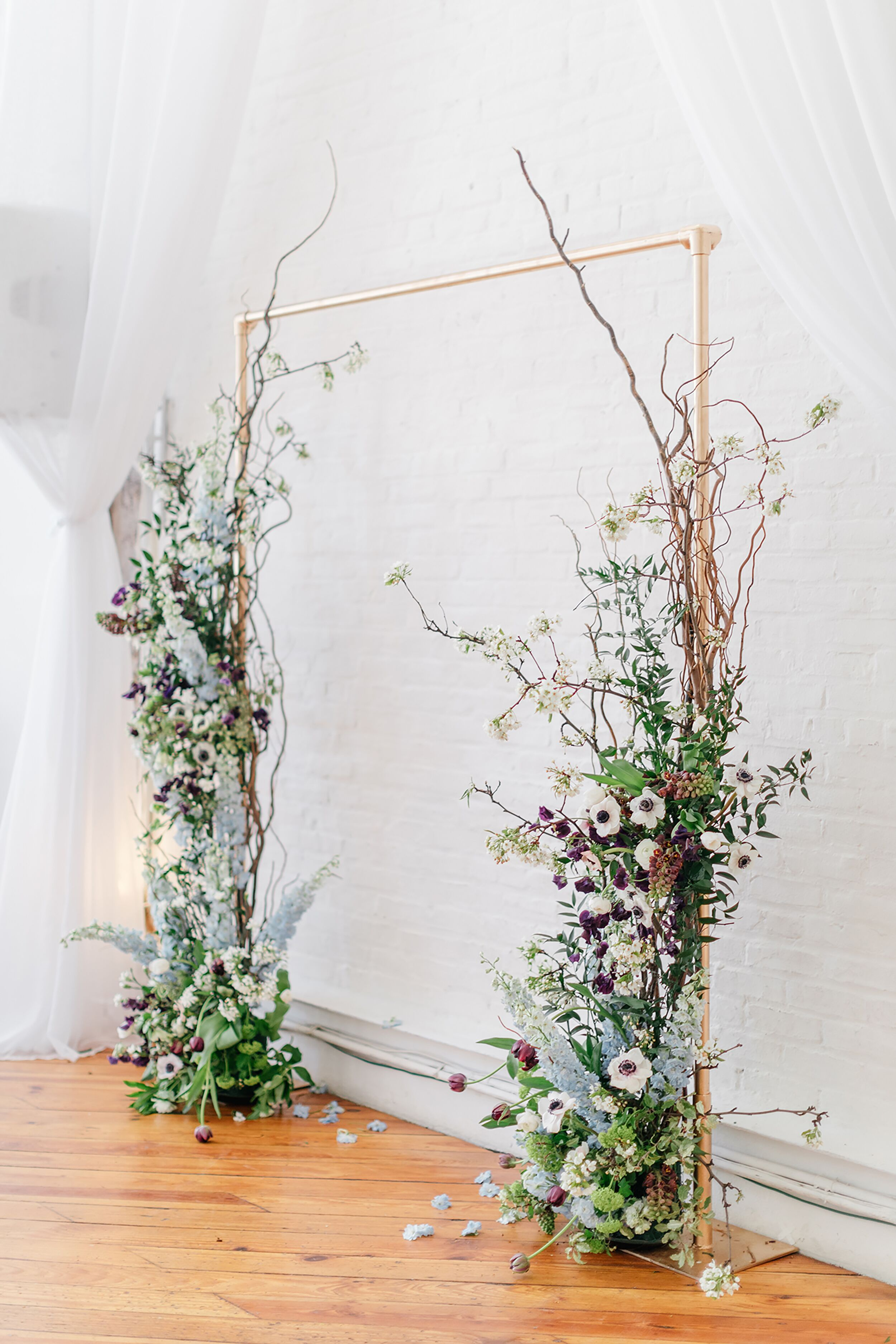 Whimsical Wedding Arch With Branches Anemones And Astilbes