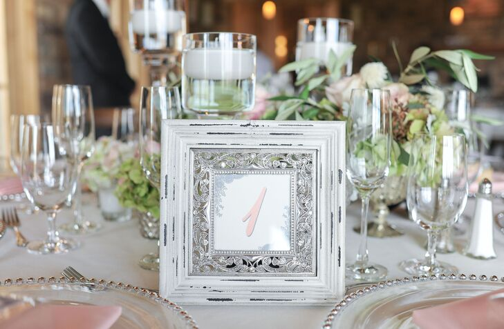 Vintage-inspired accents, like the framed table numbers, added old-world charm to the room.