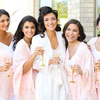 bride and bridesmaids in pink robes