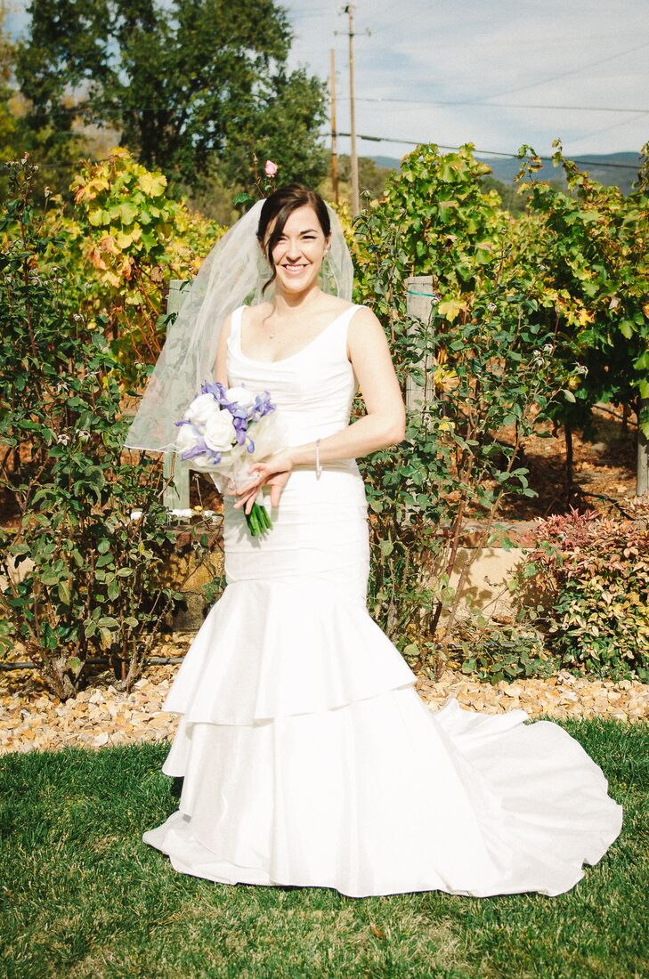 "Tracey wore a trumpet style wedding gown with a tulle veil. ""When I walked out of the dressing room, we all had that 'ah ha' moment,"" says Tracey."