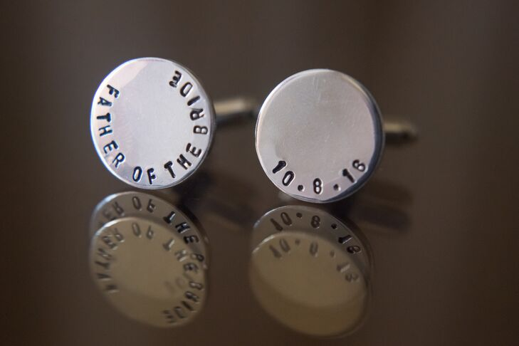 "Jenna's father sported a pair of custom silver cuff links for the wedding day. They were engraved with ""Father of the Bride"" and the wedding date."