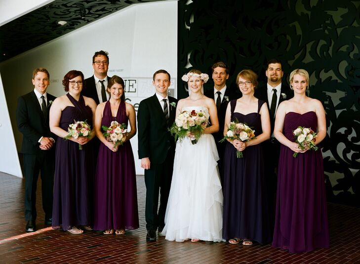 The bridesmaids wore Jenny Yoo's Aidan dresses. Two were Prussian violet and two were plum, and each lady tied the top in whatever neckline she wanted. The groomsmen wore their own black suits and white shirts. Hugo Boss ties and plum pocket squares completed their look to bring the wedding party look together.