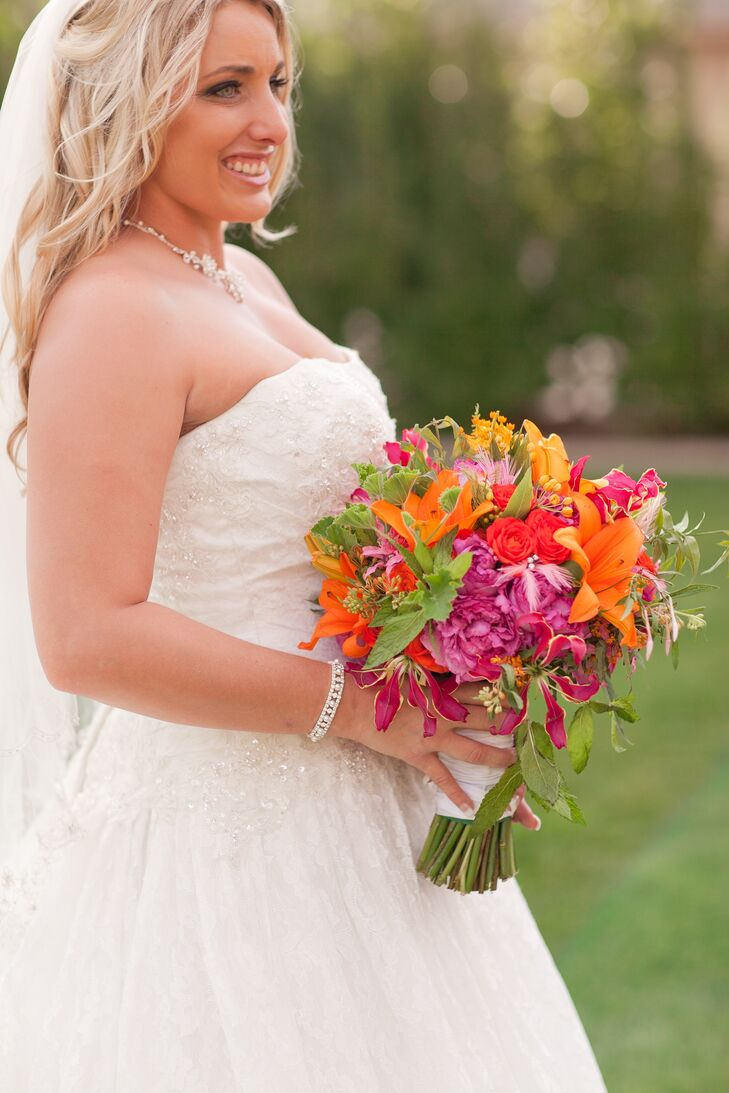 Nikki carried garden roses, peonies, lilies, hydrangeas, stock, alstroemeria and fern in her lush bouquet.