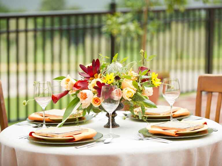 Low colorful rose, sunflower and tulip centerpiece