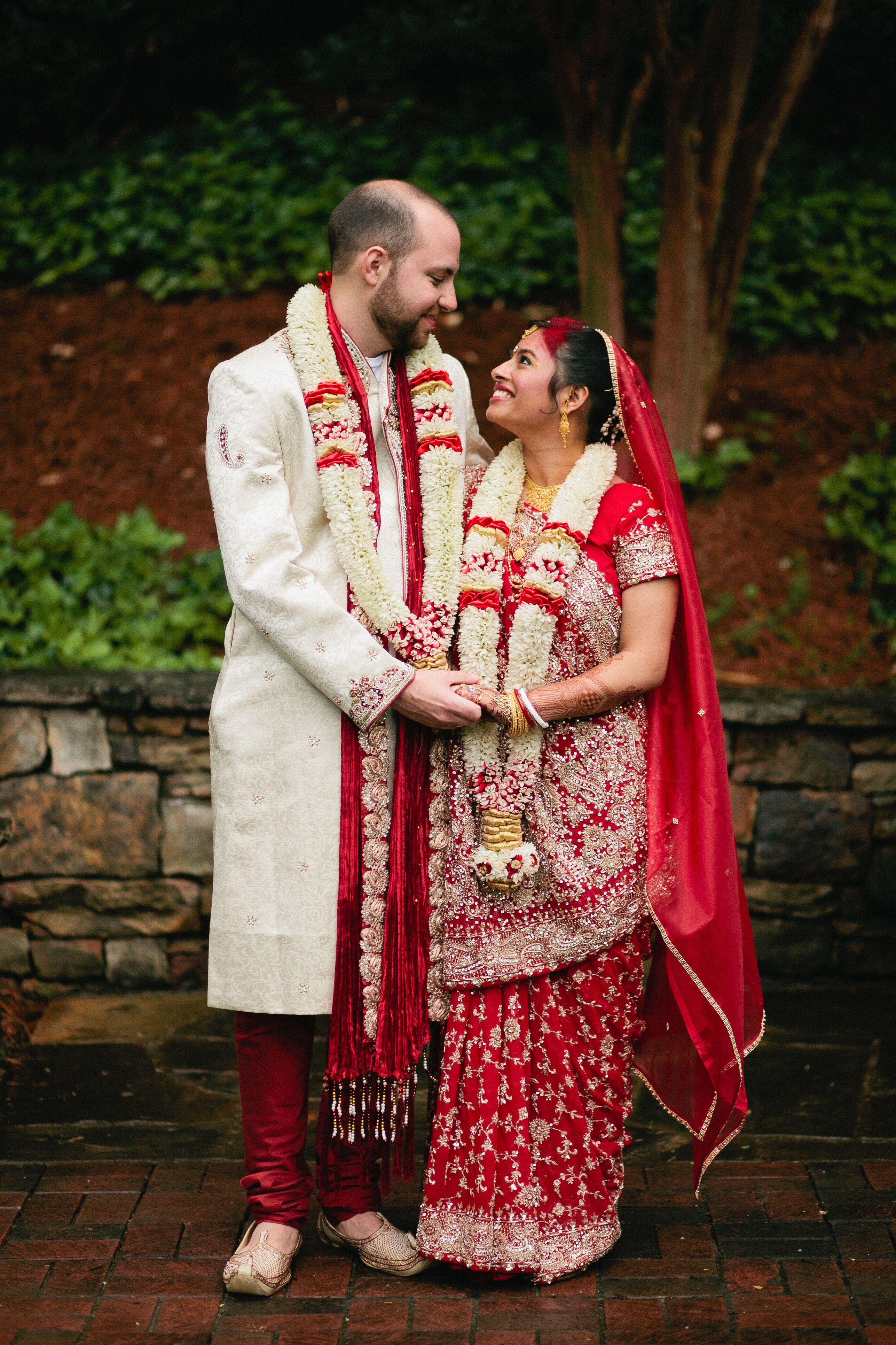Bride And Groom In Red Traditional Indian Wedding Attire