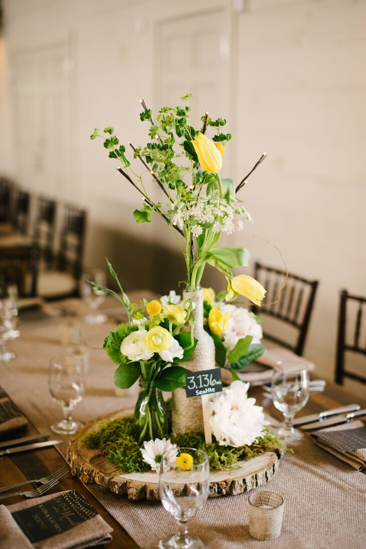 Rustic yellow and white ranunculus centerpieces