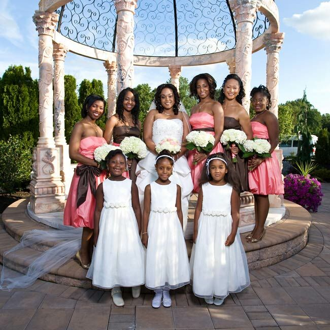 The bridesmaids' flirty knee-length, bubble-hem dresses were a steal at just $60 each! Each maid chose to wear coral or chocolate brown with a contrasting sash at the waist.