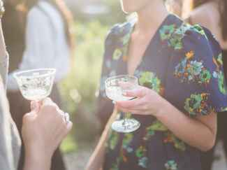 Guests drink out of vintage glasses at party