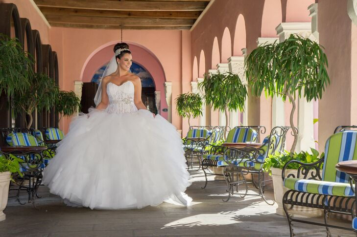 "The bride chose an Eve of Milady ballgown with a lace bodice and tulle skirt from Boca Raton Bridal. ""It was my princess dress,"" says Alina."