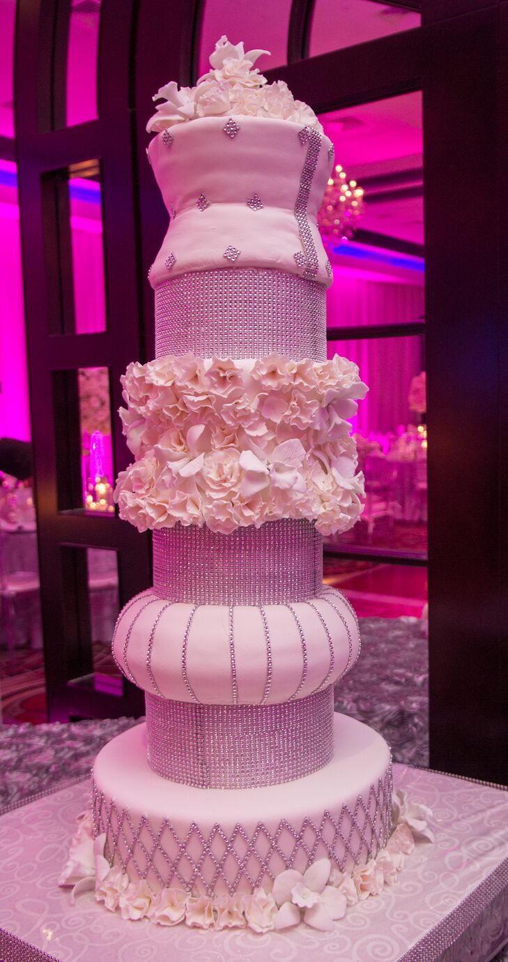 "The couple's wedding cake was a surprise from Rafael. He had the seven-tier cake replicated by the VIP Caterers from a picture Alina gave him. ""It was a real centerpiece of the night,"" says Alina."